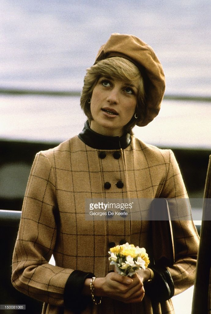 The Princess of Wales visits Twyn in Wales, November 1982. She wears a suede beret by John Boyd and a coatdress by Arabella Pollen.