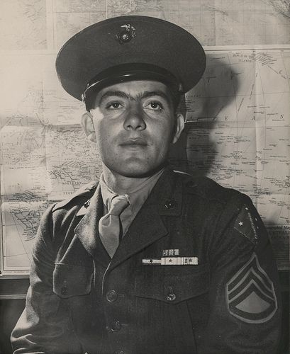 """John Basilone, September 1943  """"Marine Congressional Medal of Honor Hero Platoon Sergeant John Basilone, USMC, recently visited the Marine Headquarters at Washington, DC. Pl. Sgt. Basilone's home is Raritan, NJ. He was awarded the Congressional Medal of Honor for """"extraordinary heroism and conspicuous gallantry in action above and beyond the call of duty."""""""""""