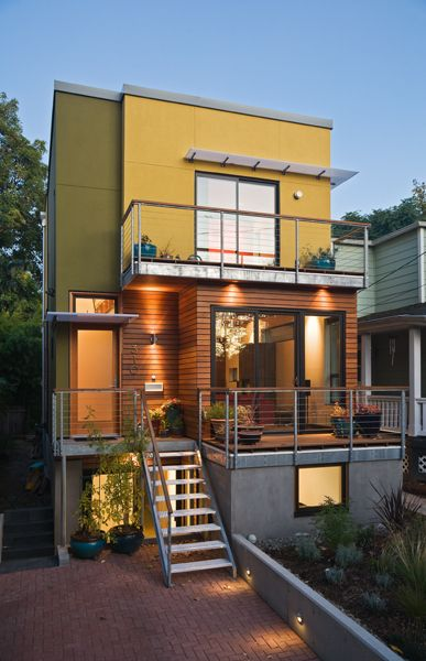 SE Urban Small Lot - Portland, Oregon - modern house - green infill project - designed by Brian Paul Sweeney Architecture - green roof - upcycled beams - low-maintenance, eco-friendly materials. Photo by David Papazian
