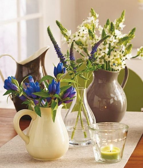 always have fresh flowers in jugs and funky containers around the house