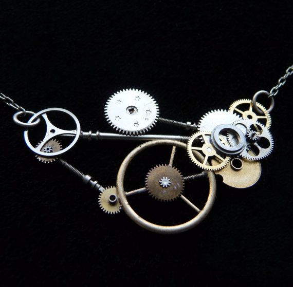 Factory is made from the parts of very old watches (some from 19th century pocket watches) that have been disused and given or thrown away. Her parts include steel gear train gears, face gears, and antique European balance wheels. Rather than just being glued onto a chain, her parts have been stripped from watch movements, cleaned, and hand arranged into a new lifeform. All of her pieces are soldered on (never glued and resin-ed) using a silver bearing lead free solder which will last…