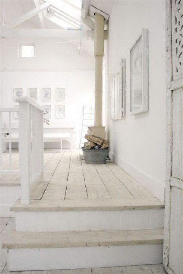 Whitewashed floorboards continuing onto the staircase.