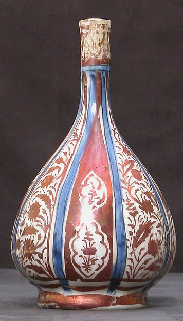 Bottle  Date:17th century Geography:Iran Culture:Islamic Medium:Stonepaste; luster-painted on opaque white and blue glaze Dimensions:H. 7 1/2 in. (19.1 cm)
