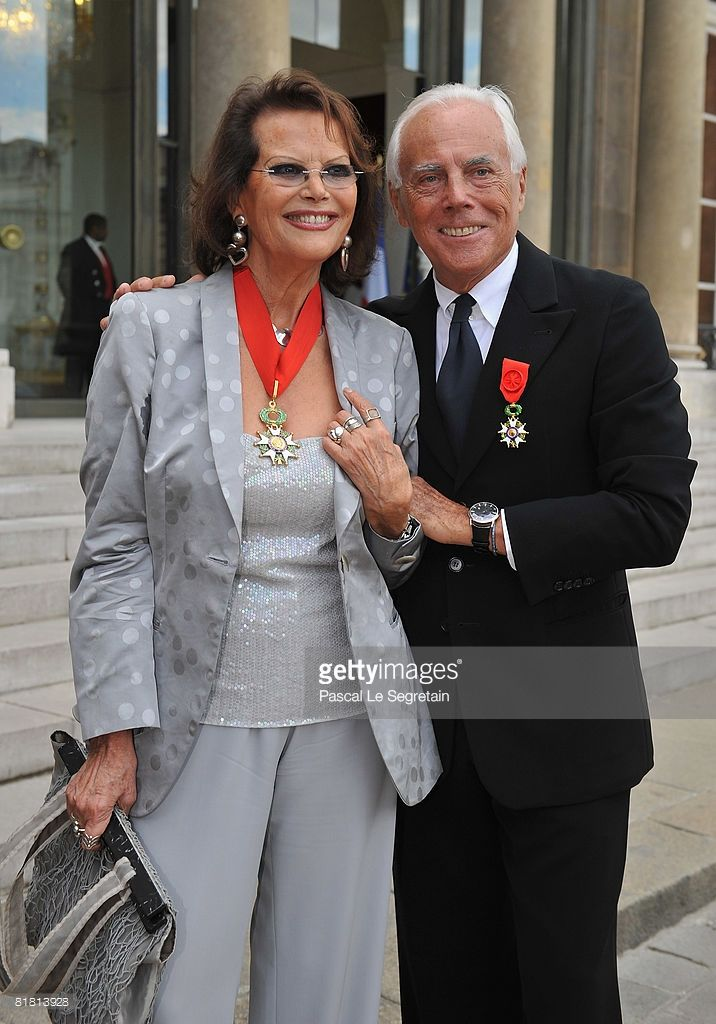 Italian actress Claudia Cardinale (L) and Italian fashion designer Giorgio Armani pose with their Legion of Honour medals in the courtyard of the Elysee Palace after attending a ceremony at the president's official residence for honorees of France's most prestigious Legion D'Honneur award on July 3, 2008 in Paris, France.