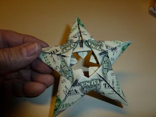 """Easy money"" folded five pointed origami star"