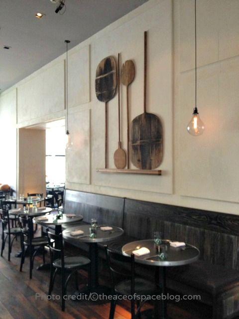 Restaurant no. 246 handblown lightbulbs, pizza paddles wall display, plaster walls-hand applied TADELAKT.