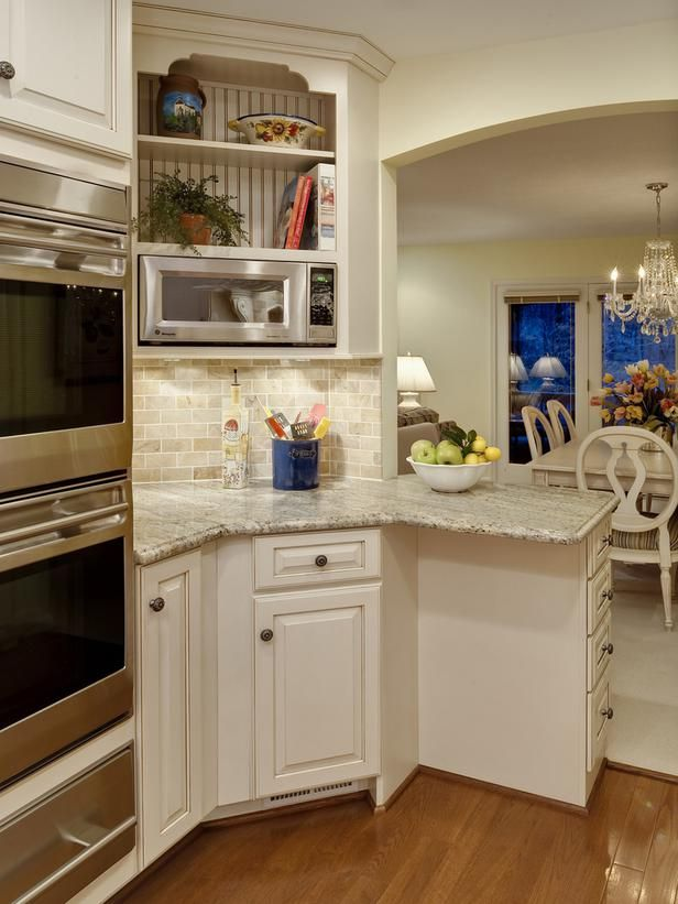 English Country Kitchen...HGTV, picture 3...looks like River White Granite countertops...knobs for cabinet and drawer pulls here.  I wish the tile backsplash was less tan, and had more of a green or gray cast to it...