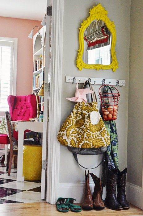 Good entryway idea. I would add a place for keys, trays or baskets for the shoes, and a coat rack in the opposite corner.