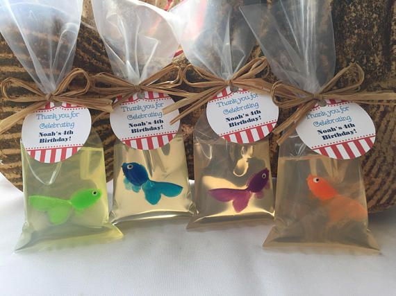FISH IN A BAG SOAP SET OF 10 Get ready for a fun and playful children's birthday party favor! Perfect for carnival, under the sea, pirate, nautical or beach themed parties, these handmade soaps feature cute little plastic fish inside clear soap: Fish in a bag soap! Each order of