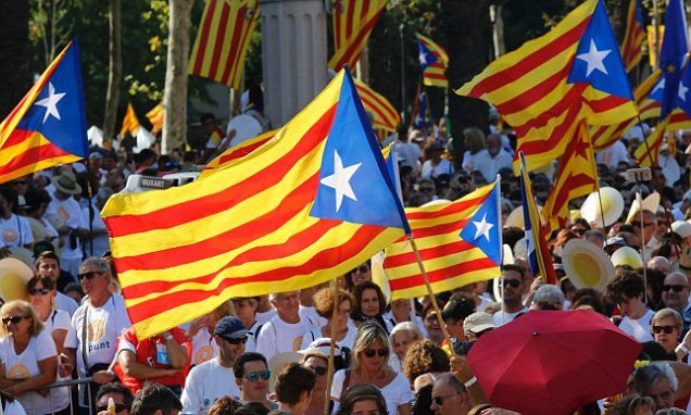 Thousands march across in Spain to demand independence for Catalonia …