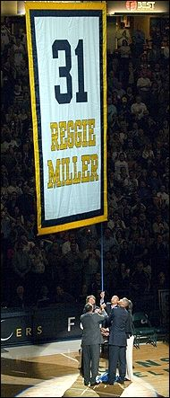 Assisted by his brothers and sisters, Reggie Miller hoists his banner into the Conseco Fieldhouse (now Bankers Life Fieldhouse) rafters.
