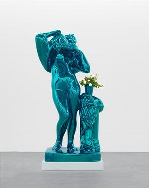 Jeff Koons, Metallic Venus, 2010 -12. Mirror-polished stainless steel with transparent color coating and live flowering plants; 100 x 52 x 40 in. (254 x 132.1 x 101.6 cm). Private collection; courtesy Fundación Almine y Bernard Ruiz-Picasso para el Arte