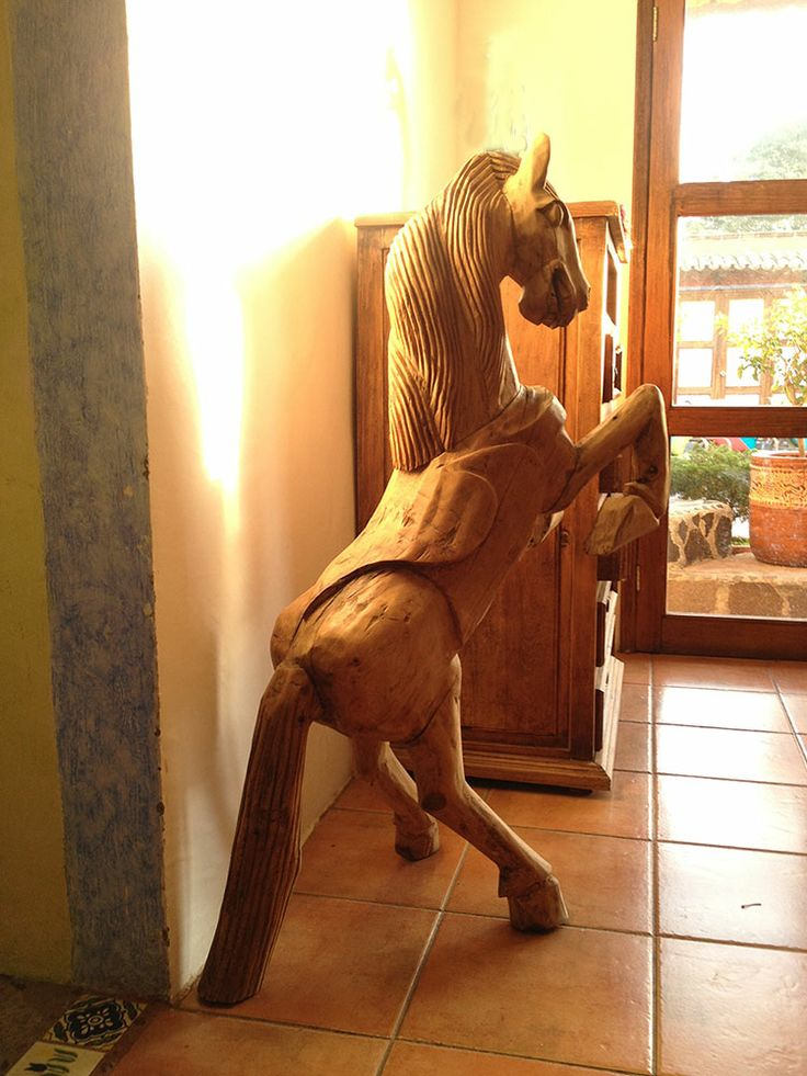 Hand carved Mexican horse sculpture.