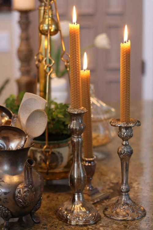 .natural beeswax in silver candleholders is so warm and inviting, love the combination