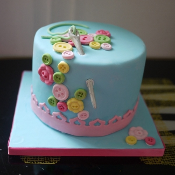 """If you take out the sewing needle, would be a cute """"cute as a button"""" bday party theme cake!"""