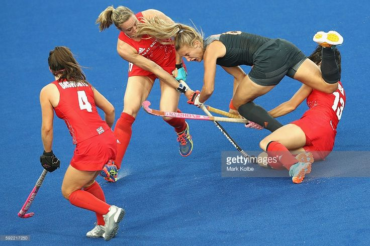 Laurien Leurink of Netherlands is tackled by Laura Unsworth (l) Kate Richardson-Walsh (c) and Sam Quek (r) on Day 14 of the Rio 2016 Olympic Games at the Olympic Hockey Centre on August 19, 2016 in Rio de Janeiro, Brazil.