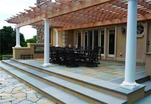 This patio cover goes well with the architecture and provides the perfect transition point between indoor and out. Landscape by Christensen Landscape Services in Northford, CT. For more patio and pergola design ideas, visit: http://www.landscapingnetwork.com/pergolas/