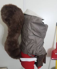 Continuing on with my lookback at the props I have made in the past this week I'm focusing on my Squirrel Girl tail and belt. The tail is version 2 (the first one was too heavy and a little clunky looking lol) I made the pattern out of poster board and used teddy bear fur and pillow stuffing for the interior. It is secured onto the jacket with 2 jumbo snap buttons and hot glue. The pouches are made from basic shapes cut from craft foam and covered with fabric. The belt buckle is craft foam…