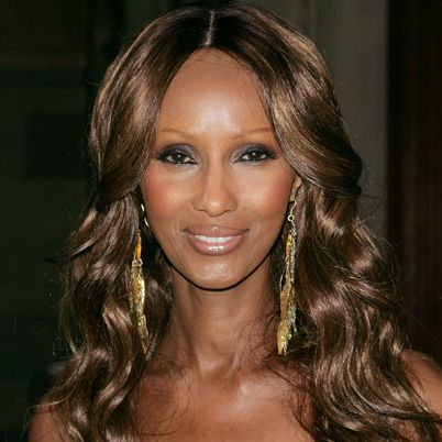 """Iman is 55. She was born on July 25, 1955, in Mogadishu, Somalia. A student at the University of Nairobi, she was discovered by photographer Peter Beard. Through the 1970s and 1980s, Iman was a favorite model in Vogue and Harper's Bazaar. Fashion designer Yves Saint Laurent devoted the """"African Queen"""" collection to her. Since retiring from modeling, Iman has done charity work in Somalia. Iman is sometimes described as her native land's most famous export."""