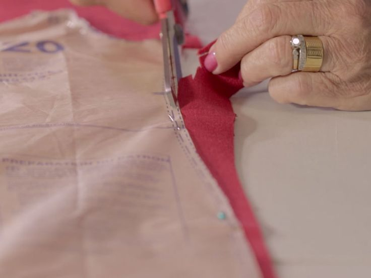 Cut fabric with pinned paper pattern