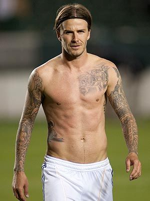 David Beckham.  The only guy who can get away with wearing a headband ;)