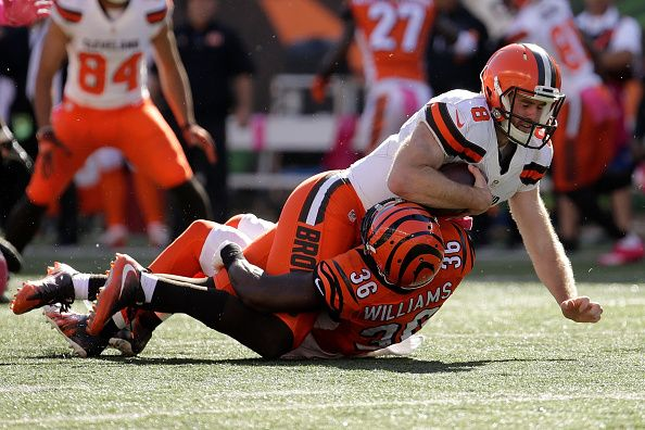 Browns vs. Bengals:     October 23, 2016  -  31-17, Bengals  -       Shawn Williams #36 of the Cincinnati Bengals tackles Kevin Hogan #8 of the Cleveland Browns during the third quarter of the game at Paul Brown Stadium on October 23, 2016 in Cincinnati, Ohio. (Photo by Andy Lyons/Getty Images)