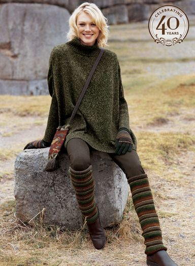 """Our Bohemian Tunic floats over the body in an oversized silhouette with a rib knit mockneck and narrow sleeves.  Handframed in a soft mélange tweed of olive, indigo and brown pima, the 28"""" long tunic has two ribbed patch pockets."""
