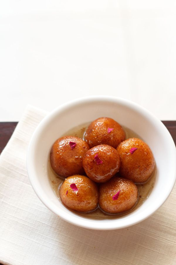 gulab jamun recipe - an easy recipe of gulab jamun made with khoya/evaporated milk, paneer/cottage cheese and all purpose flour/maida. step by step recipe.