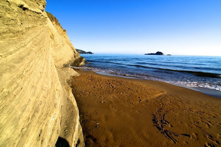 Arillas Beach, Corfu  Known as lover's beach this two kilometer long beach is ideal for an afternoon stroll as the sun dives into the Ionian Sea.