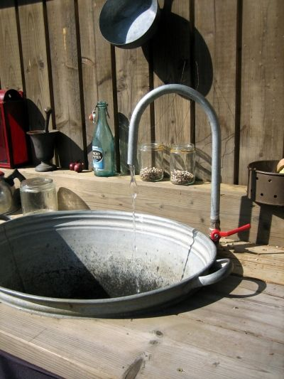 must have outdoor sink! re. Outdoor Kitchen  I'm to make me one of this, since during the spring, I'm outdoors planting!!! Love it!!