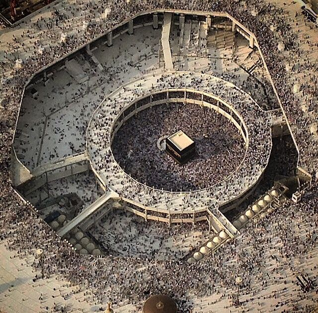 ☪ The Kaaba or Ka'aba is a cuboid building at the center of Islam's most sacred mosque, Al-Masjid al-Haram, in Mecca, Saudi Arabia. It is the most sacred site in Islam. Wherever they are in the world, Muslims are expected to face the Kaaba – i.e. when outside Mecca, to face toward Mecca – when performing salat (prayer). From any point in the world, the direction facing the Kaaba is called the qibla.