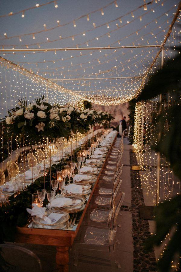 A Magical Wedding In Santorini Under A Canopy Of Fairy Lights Ruffled In 2020 Lights Wedding Decor Wedding Lights Wedding Decorations