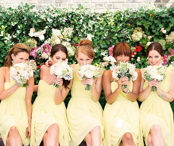 Yellow bridesmaids' dresses from Donna Morgan. Click to see behind the scenes photos from this photoshoot!