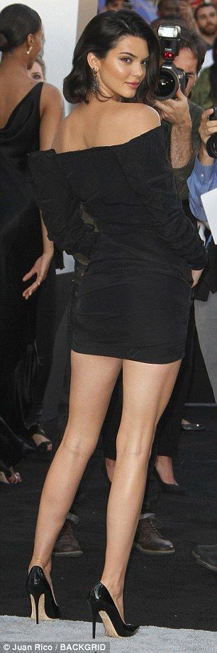 Sensational: The beauty accentuated her height with a pair of patent leather heels...