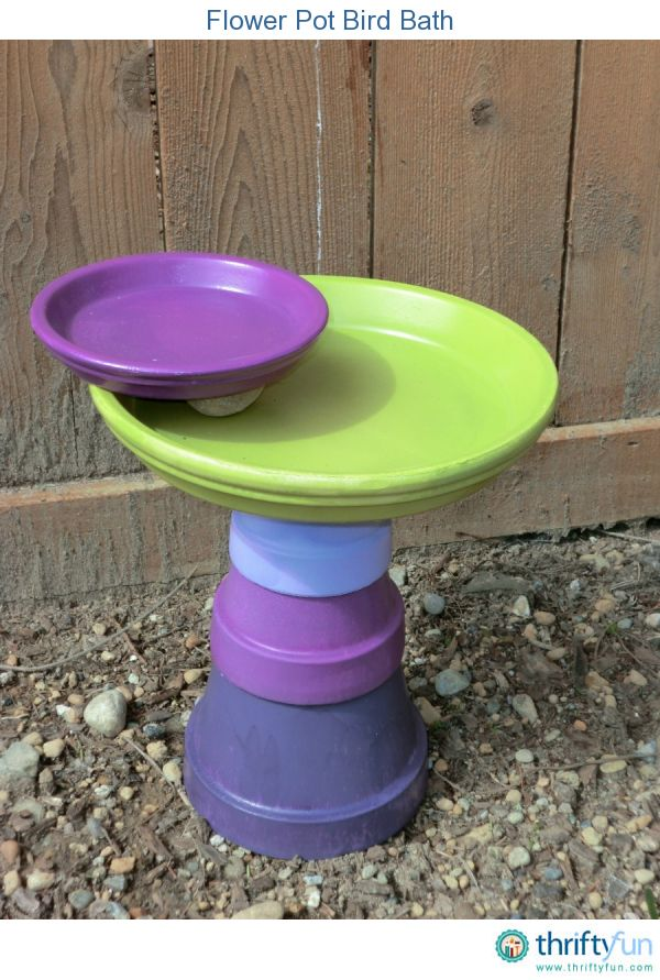 flower pot bird bath >> I am going to do this, but with different colors for a corner in my yard! Maybe add some rope too...