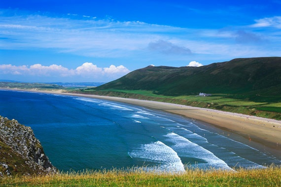 Swansea is a coastal city and county in Wales. Situated on the sandy South west Welch coast, the county area includes the Gower Peninsula and the Lliw uplands