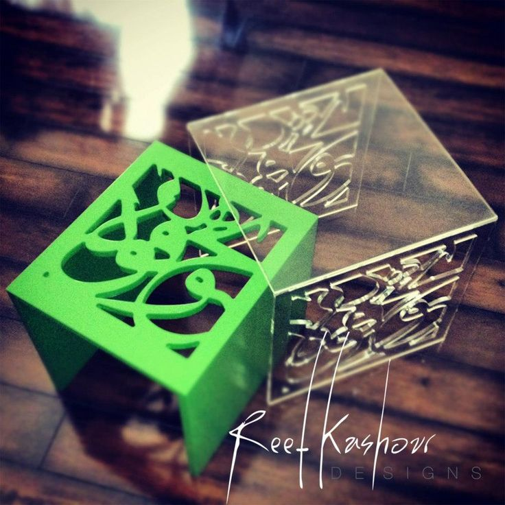 A set of two nesting tables, wood and plexi glass. Arabic calligraphy. @Reef Kashour