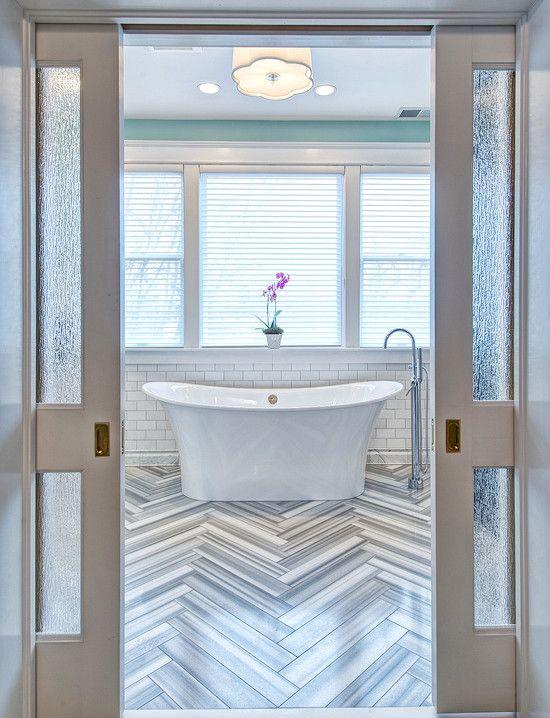beautiful herringbone tile in the bathroom