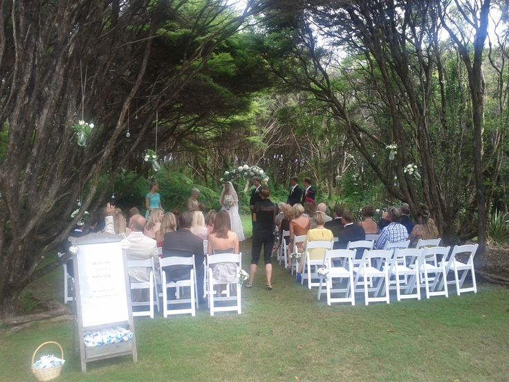 Outdoors under the trees in a tranquil glade. Styled by Waiheke Island Weddings and Events.