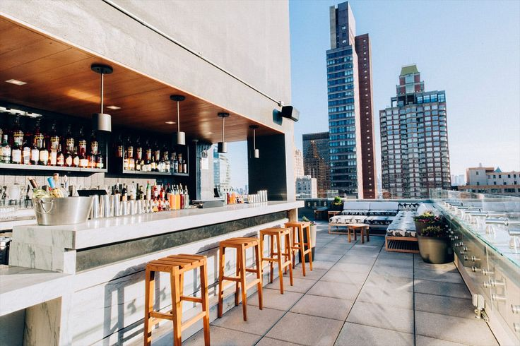 These 11 rooftop bars from around the world boast showstopping views, serious cocktails and dynamite menus from acclaimed chefs.