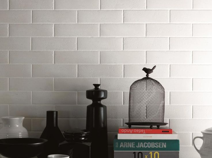 Mattone Brick Effect Bianco offer a textured surface and rustic edge to add character. These ceramic white brick tiles are a design classic. From Original Style's Tileworks collection. originalstyle.com
