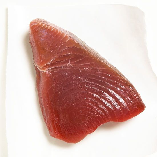 Fresh tuna steaks are versatile and easy to cook. Follow these tips and directions for grilling, skillet-cooking, and baking fresh and delicious tuna.
