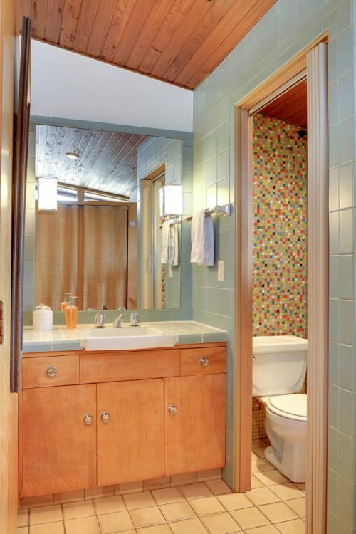 Midcentury modern tile house bathroom-LOVE the vanity, sconces and mosaic in the wc.