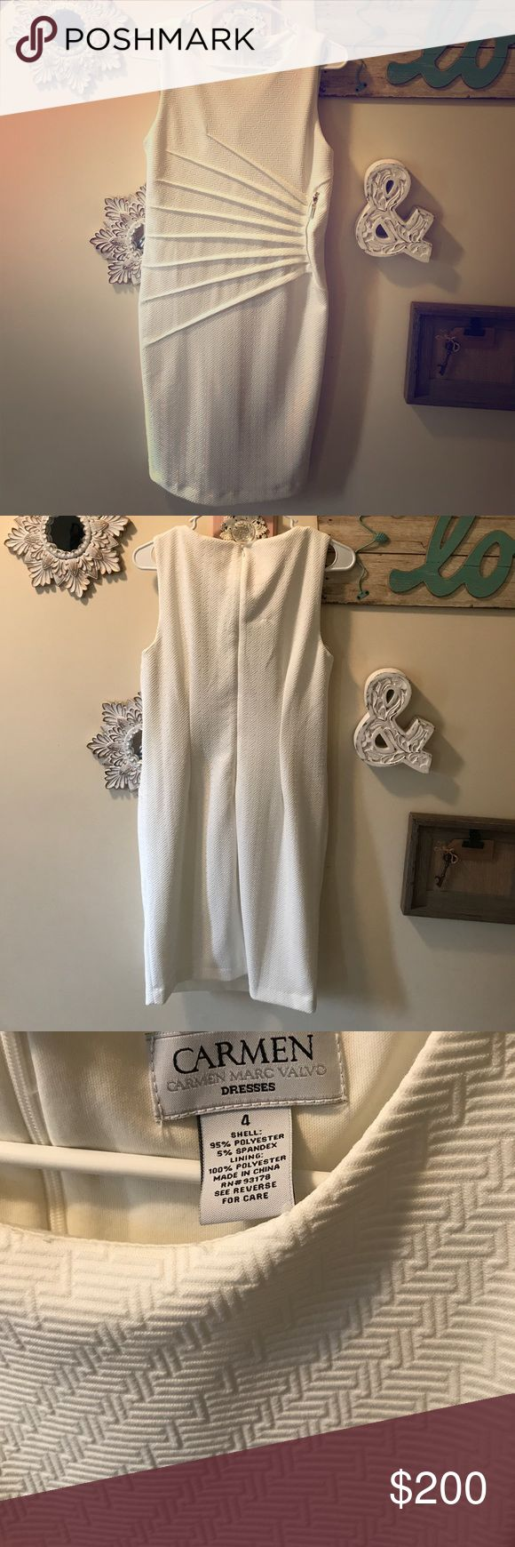 Gorgeous Woman's White Dress This is a gorgeous Woman's Dress by Carmen Marc Valvo👗 It is a size 4, but is stretchy so I would say it could fit Size 4-8! It is in perfect condition and was worn once for a couple hours at my wedding rehearsal! There are no stains, tears or holes! It has a beautiful zipper design on the front and has a zip up in the back! This is perfect for a wedding dinner rehearsal, bachelorette party or just a night out!! 👗 Carmen Marc Valvo Dresses Midi