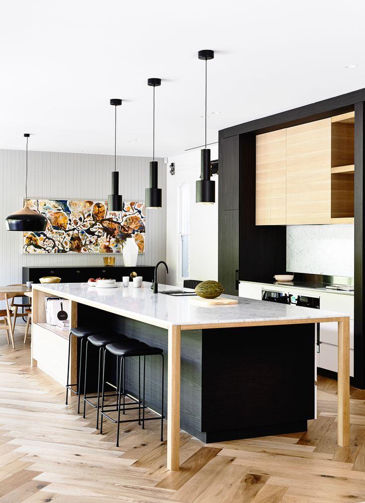 Beautfiul chevon light wash hardwood floors in kitchen design | Austin Design Associates