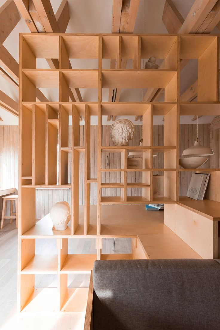 Plywood artist's studio by Ruetemple combines areas for storage, seating and…