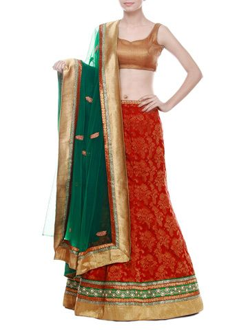 Rosso corsa banarasi brocade lehenga with tear drop stones , round studs and white beads integrated beautifully with gotta border. Contrast green net dupatta with matching two sided heavy border. Matching banarasi brocade unstitched blouse.
