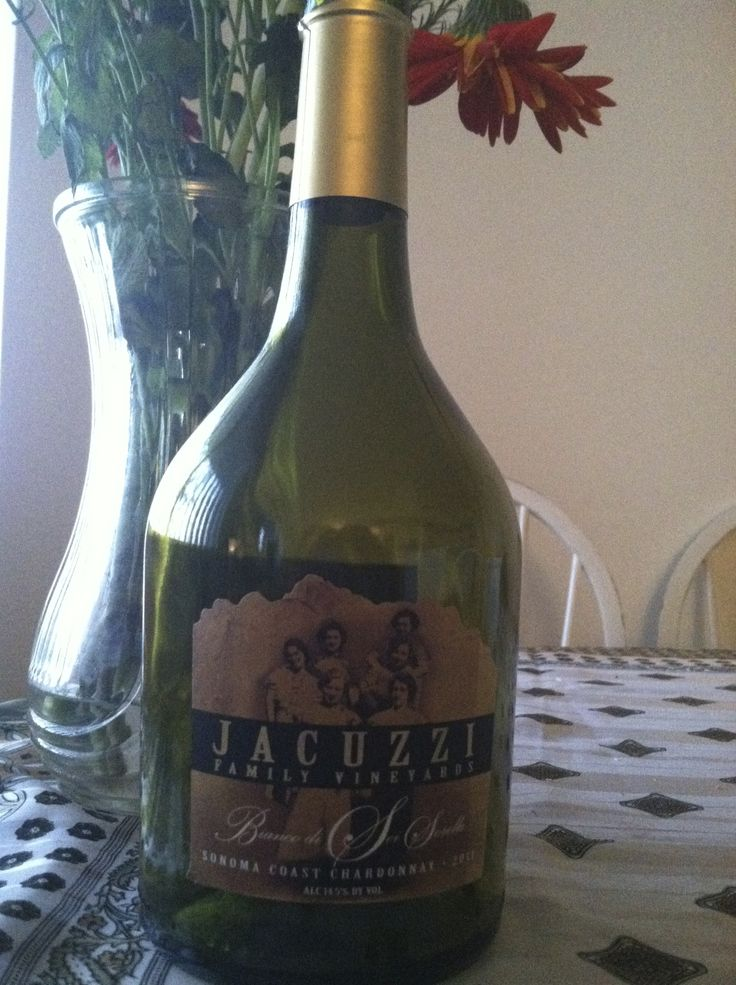 "2011 Jacuzzi Bianco di Sei Sorelle. Sonoma. A table white ""of six sisters"", from the Jacuzzi family vineyards. Great for a picnic. Bright, fresh, pear, and apples. Sells for about $18. Unique bottle shape too!"
