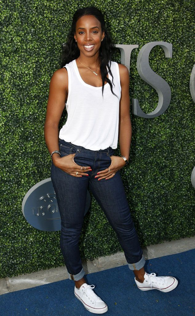 Kelly Rowland from The Big Picture: Today's Hot Pics  Say cheese! The singer is all smiles at the opening night of the U.S. Open.