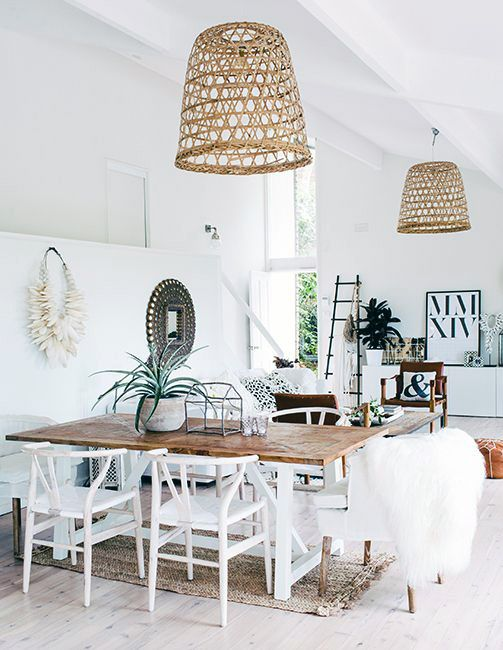I like the wooden table with white legs and then the woven lamp shades.